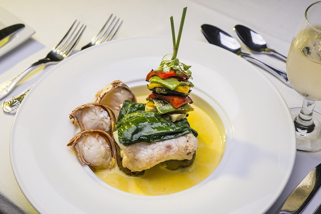 Executive Chef Sowa's succulent Coconut and Tumeric Infused Grouper With Lobster Medallions is full of Caribbean flavors! ( Image:Half Moon Bay Resort)