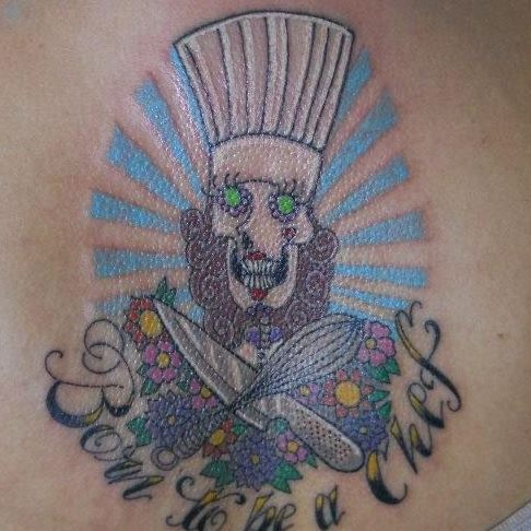 Chef J's Tattoo across her back