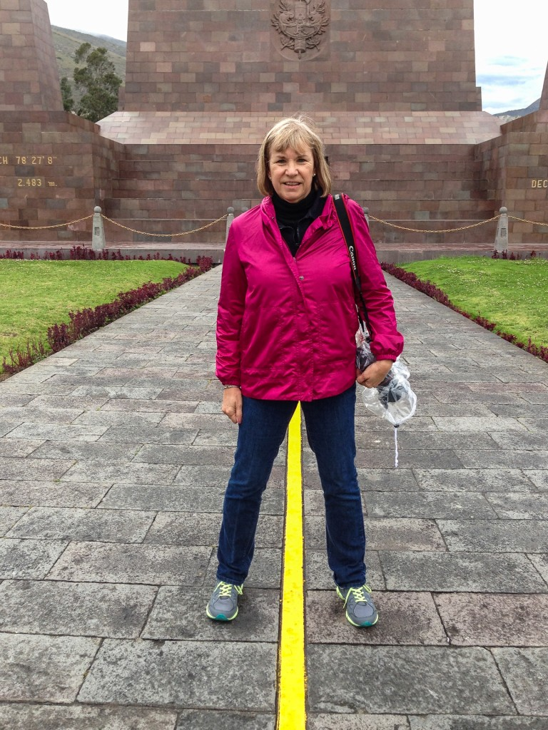 Straddling the line at the Equator.